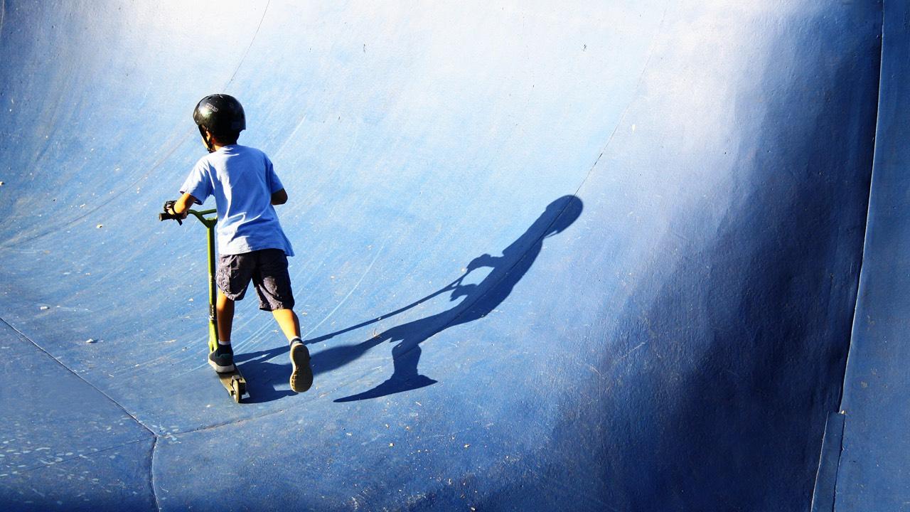 Kid with helmet on trickbike