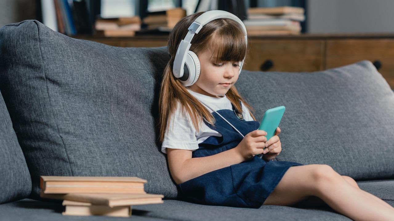 Headphones on girl looking on a smartphone